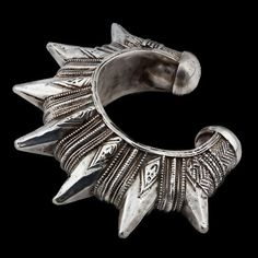 Deep in the deserts of Sindh province in Pakistan, tribal ladies of substance had their jewellery commissioned to serve protectively if the need arose. Gorgeously dangerous and yet beautifully feminine this vintage Gokhru cuff is a masterpiece of fashion design. Rare to find and startlingly noticeable, this undeniably bold cuff has incredible impact! Silver Cuff  Pakistan  Circa Mid 20th Century  Wrist Dia 7cm  Height 12cm  191g  £780.