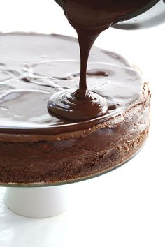 Pouring sugar-free chocolate ganache over low carb chocolate cheesecake. The best keto dessert!