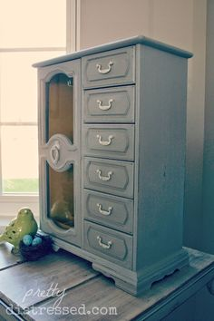Jewelry box refinished with Chalk Paint® by Annie Sloan in Paris Grey with Old White accents.