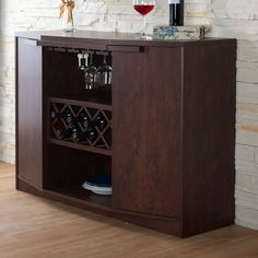 Stylishly display your collection of spirits with this modern wine cabinet, showcasing shelved cabinets and built in wine and glass racks. Its sturdy wooden construction and practical design make it a great addition to any kitchen and dining space.