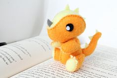 This listing is for a PDF file that can be downloaded and printed immediately after purchase. For assistance in downloading, please visit https://www.etsy.com/help/article/3949?ref=help_search_result -- At 10 cm (4 inches) tall, this adorable dragon is ready to breathe fire on