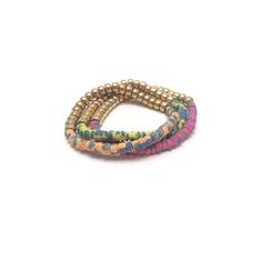 Hand-painted coconut wood beads with a bold metal section in Multicolor Gold, more colors available.