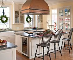 Love this Christmas kitchen--we can almost smell the gingerbread cookies! - Traditional Home®