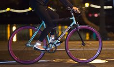 Betabrand Flipslips riding a bike with reflective fabric at night!
