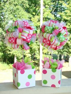 Ribbon Topiary - I would love to see these done in red, white and silver for Xmas with some Xmas picks for greenery.