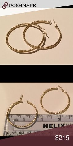 "14kt Diamond Cut Hoop Earrings NWOT These earrings are marked 14k Italy.  They are 2 mm wide and 1-3/4"" in diameter.  The pair weighs 4.2 g.  These have never been worn. Jewelry Earrings"