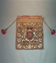 A rare Lord Chancellor's stumpwork burse (purse) used to carry the Great Seal. Sumptuously worked in silver and gilt thread on a red velvet background, the design has changed very little since Elizabethan times and incorporates the Royal Crest of Queen Victoria with the harp prominent which suggests that it may have been made for a Lord Chancellor of Ireland. Wonderful condition apart from some fading to the velvet and still retains its ties and internal stiffening boards. 18.5 inches wide x 24