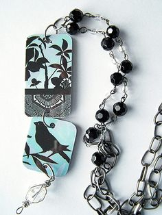 Love the pretty graphics on your depleted gift card? Turn it into a reversible necklace pendant.
