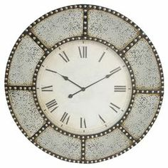 """Bring stylish appeal to your parlor or living room with this eye-catching wood wall clock, featuring a nailhead-trimmed frame.   Product: Wall clockConstruction Material: WoodColor: Cream and brownFeatures: Nailhead trimAccommodates: Batteries - not includedDimensions: 36"""" Diameter x 3"""" D"""