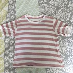 Pink and White Striped Nadine cropped Nadine top from Brandy Melville. there is a faded gray mark on the collar but your hair will probably cover it. only worn twice Brandy Melville Tops Tees - Short Sleeve