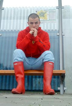 Matching boots and hoodie, looking great on a bench.