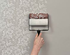 easy detailed touch with Patterned Paint Rollers. --- The finished product is very good, but now i need a DIY to make my own pattern paint roller :P Classic Wallpaper, Of Wallpaper, Wallpaper Roller, Painted Wallpaper, Wallpaper Ideas, Wallpaper Awesome, Wallpaper Designs, Shabby Chic Wallpaper, Bedroom With Wallpaper Accent Wall