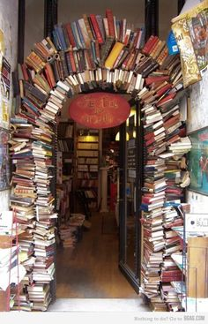 The arch of books forms a doorway :)