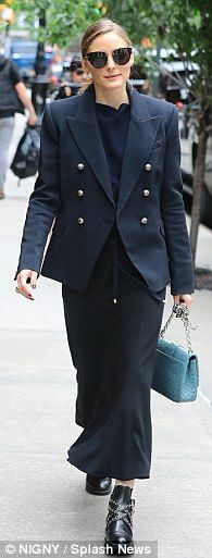 Chic: The 31-year-old fashion maven - who doesn't have a stylist - paired a brass-buttoned blazer with a midi-length skirt, sweater, black chain booties, and Tiffany-blue purse