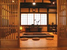 i'd love to have an Japanese irori in my house someday. love the sasshi sliding doors too - irori building company