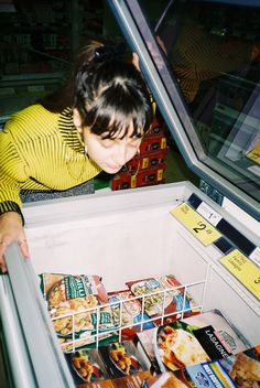 Grocery Shopping by Haley Canter | @haley.canter  #food #groceries #freezer #shopping #35mm #film #photography #shop #munchies #eat #retro #vintage #color #bright #yellow #fruit #chips #eating #girl #girls #fashion #indie #hipster #bangs #fringe #brunette #shop #store #grocers #buying #good