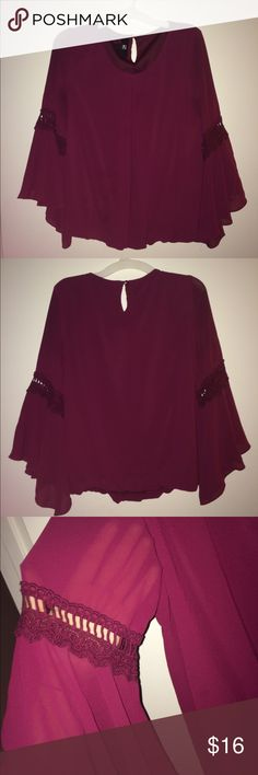 "Burgundy ""flowy"" blouse!! Worn minimal times and is super cute with a pair of jeans!! Very sheer and light!! Iz Byer Tops Blouses"
