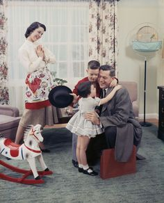 The ideal family of the 1950s....we even had a parakeet hanging on a cage stand like this one.
