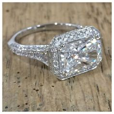 Emerald cut east-west diamond engagement ring