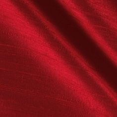 Dupioni Silk Fabric Red from @fabricdotcom  Dupioni silk fabric has a lustrous sheen and characteristic small slubs that run horizontally across the fabric. It falls in soft folds when draped and is the most versatile fabric we carry. Not only do many brides choose dupioni silk fabric for themselves and their bridesmaids, it is also perfect for blouses, jackets, skirts, handbags and dresses. Be creative with beautiful home decor accents (draperies, swags, pillows and duvet covers).
