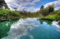 Infinity pool overlooking a valley and rice terraces at the Komaneka at Tanggayuda in Ubud, Bali