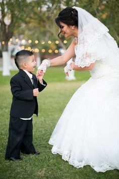 Bride and her son giving her a kiss on the hand