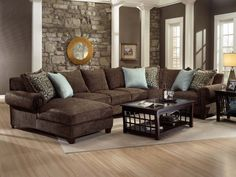 dark brown couch in family room | choose furniture coordinated complements the brown couch with a set of ...