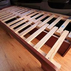 "Van conversion slat bed: 15 slats on each half and two hinges per half for the lifting. Make one of the slats extra long on each half, so that it latches on to the part that slides in and out, this will allow them to connect together when the ""lid"" is lifted to access storage. Slides out or lifts for storage."