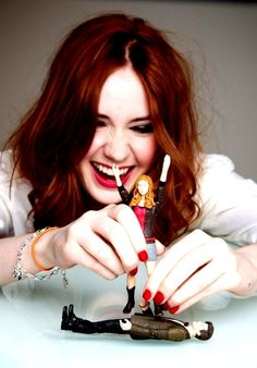 Karen Gillan playing with Dr. Who action figures, including that of her own character Amy Pond. I don't know if this is ironic or not but I find it very funny