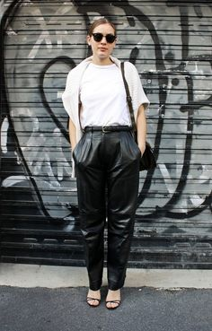 White tee and sweater with loose-fitting leather pants