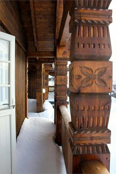 Norwegian carving on cabin at Filefjell Mountain, Norway. - close up of pillars.