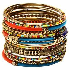 "Whether worn individually or as part of a vibrant set, these gold-plated and beaded bangles add color and shine to all your favorite ensembles.   Product: 18-Piece bangle setConstruction Material: Brass and resin beadsColor: Multi and goldFeatures: Can be worn stacked or single Dimensions: Extra Small: 6"" Inner circumferenceSmall: 7"" Inner circumferenceMedium: 8"" Inner circumference"