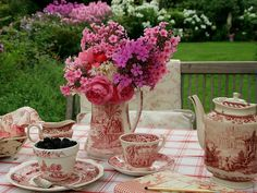 I'm thinking about using various vintage china I've collected and I love red transferware. Some of it is really closer to pink and it looks very pretty with pink depression glass.
