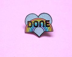 This awesome glitter DONE enamel pin is perfect for those days when you are done with whatever B.S. the world is throwing at you! Featuring a white glitter heart and pastel rainbow, with DONE emblazened across the front, this sassy silver hard enamel pin is the perfect addition to your collection! Measurements: 25mm wide, secured with a rubber clutch back and presented on a cute backing card.  If youd like to keep your pins safe & sound I also sell locking pin backs for 75p each: www.etsy...