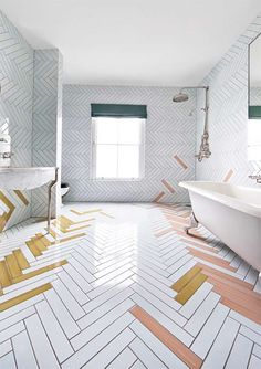 bathroom tile ideas - made a mano - Make a boring white bathroom exciting by laying tiles in a herringbone pattern and layering in a touch of color. White Bathroom Tiles, Bathroom Floor Tiles, White Tiles, Bathroom Wall, Bathroom Tile Patterns, Cheap Bathroom Flooring, Bath Tiles, Shower Floor, Bathroom Layout