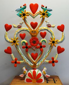 My donation for the NM Cancer Foundation's upcoming fundraiser, Valentine's Day 2014 - in honor of my brother Jimmy Romero who died of cancer in 2010. Hand carved, hand painted, original design. Sweetheart tree of life.