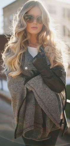 LOVE this entire look! The cape coat with the leather gloves, the sunglasses, the big and soft curls. I'd totally wear this!