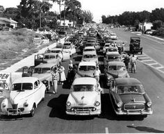 People and automobiles waiting to cross the new Sunshine Skyway Bridge on September 7, 1954. In the first eleven hours, 15,086 vehicles made the trip. | Florida Memory