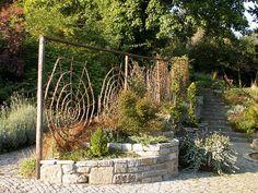 Chalice Well Gardens: Spiral Wall by phoenixspringwater, via Flickr