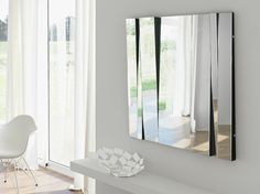 This modern mirror design can create amazing room ideas, especially living room ideas. This kind of design mirror can give style to almost every living room ideas | Discover more mirror ideas: www.bocadolobo.com