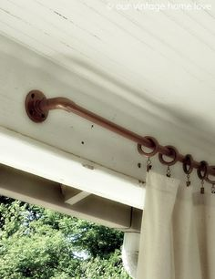 Spray paint some plastic PVC pipe to make it LOOK like copper and turn that into a great curtain rod.