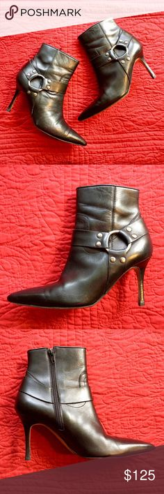 Manolo Blahnik Leather Booties This fashion-forward pair of authentic Manolo Blahnik leather booties are in excellent pre-worn condition. With strap and hardware detailing along the ankle,  these booties are unique while still being ultra stylish! | Authentic | Leather | Heel Height: 3.5 in. | Manolo Blahnik Shoes Ankle Boots & Booties