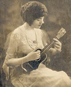 Woman plays a Ditson ukulele - 1921 Vahdah Olcott-Bickford (1885 - 1980) plays a Martin made Ditson professional ukulele. She wrote a book: 'The Bickford Method for the Ukulele', which stated: 'No attempt has been made to make more out of the ukulele than its capacity warrants'.