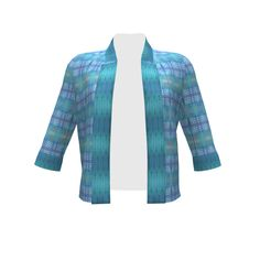 By Hand London Victoria Blazer made with Spoonflower designs on Sprout Patterns. A product of the SAGE Group.  Fabric prints used are Ikat Adinkra Primitive in Blue by wren_leyland and Feather Stripe Deep by shi_designs.
