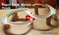 Use the rims of paper plates to make a marble track!