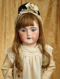 "April 18th Rendezvous Auction http://theriaults.proxibid.com | 32"" French bisque bebe by SFBJ with original body and pretty antique costume. $600/900"