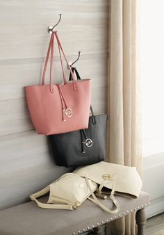 Designer-brand reversible tote with a matching convertible bag! Get awesome discounts up to 30% Off at Stein Mart using Mother's Day Promo Codes.