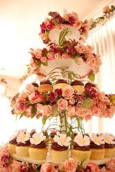 Such a lovely cupcake tower with beautiful flowers - perfect for a spring garden wedding #wedding #cupcakes #cupcaketower #weddingcupcake #flowers