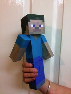 Minecraft Steve paper model, a little over 1 foot long, so cute for party table decor! They also have a creeper model too.