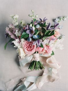 Pink and lavender bridal bouquet | 12 Stunning Wedding Bouquets via @BelleMagazine